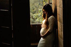 pregnant woman in window