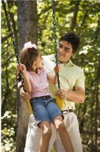 Dad with child on swing