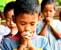 children praying form Compassion International