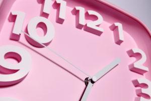 close up of a pink clock face